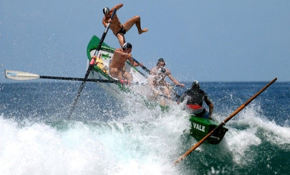A surf boat crew gets airborne (Photo: Jon Dibbs). A 15-year-old rower, Robert Gatenby, was drowned at Aussies at Kurrawa Beach in 1996 after a collision with another surf boat in cyclonic conditions.
